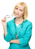 Portrait of a woman wearing doctor uniform Stock Images