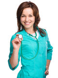Portrait of a woman wearing doctor uniform Royalty Free Stock Photos