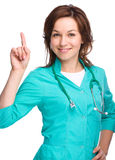 Portrait of a woman wearing doctor uniform Royalty Free Stock Photography