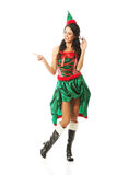 Portrait of woman wearing elf clothes pointing to the left Stock Photos