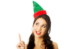 Portrait of woman wearing elf clothes pointing up Royalty Free Stock Images