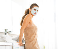Portrait of woman wearing facial cosmetic mask Royalty Free Stock Images