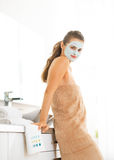 Portrait of woman wearing facial cosmetic mask Stock Photography