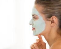 Portrait of woman wearing facial cosmetic mask Stock Photo
