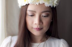 A portrait of a woman wearing a flower crown stock images