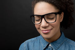 Portrait of a woman wearing glasses. On a black background Stock Image
