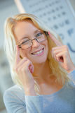 Portrait woman wearing glasses and winking Royalty Free Stock Image