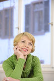 Portrait of a woman wearing a green sweater Royalty Free Stock Image