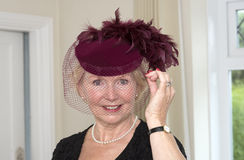 Portrait of a woman wearing hat with feathers and veil Royalty Free Stock Photos