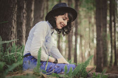 Portrait of Woman Wearing Hat in Forest Stock Photography
