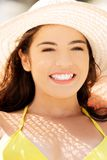 Portrait of a woman wearing hat sunbathing Royalty Free Stock Photos