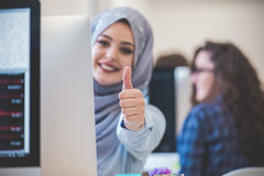 Portrait of woman wearing hijab and giving thumbs up Stock Photos