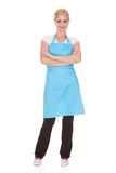Portrait of woman wearing kitchen apron Stock Image