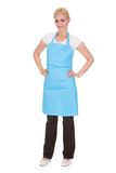 Portrait of woman wearing kitchen apron Stock Photos