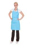 Portrait of woman wearing kitchen apron Stock Photos
