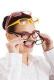 Portrait of a woman wearing many eyewear Stock Image