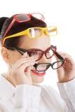 Portrait of a woman wearing many eyewear Stock Photos