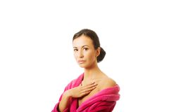 Portrait of a woman wearing pink bathrobe Royalty Free Stock Photography