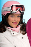 Portrait of woman wearing pink snowboard helmet Royalty Free Stock Photography