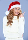 Portrait of an woman wearing a red Santa hat Stock Photo