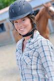 Portrait woman wearing riding helmet Stock Photography