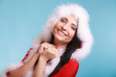 Portrait woman wearing santa claus costume on blue Stock Photos