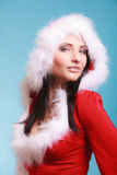 Portrait woman wearing santa claus costume on blue Royalty Free Stock Image