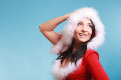 Portrait woman wearing santa claus costume on blue Stock Photography