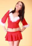 Portrait woman wearing santa claus costume on yellow Stock Photos