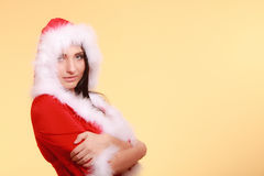Portrait woman wearing santa claus costume on yellow. Beautiful sexy woman wearing santa claus costume clothes on yellow background Royalty Free Stock Photo