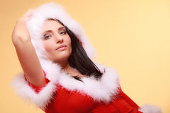 Portrait woman wearing santa claus costume on yellow. Beautiful sexy woman wearing santa claus costume clothes on yellow background Stock Photos