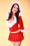Portrait woman wearing santa claus costume on yellow. Beautiful sexy woman wearing santa claus costume clothes on yellow background Royalty Free Stock Photography