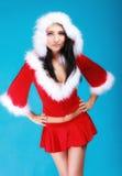 Portrait woman wearing santa clause costume on blue Stock Photos