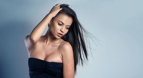 Woman wearing a sexy black dress Stock Image