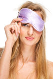 Portrait of woman wearing a sleeping mask Stock Photos