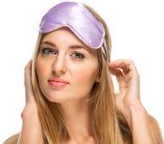 Portrait of a woman wearing a sleeping mask Stock Photo