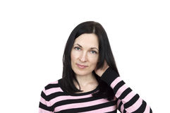 Portrait of a woman wearing striped sweater posing. Isolated over white Stock Images