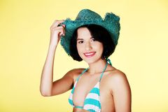 Portrait of a woman wearing summer hat Royalty Free Stock Images