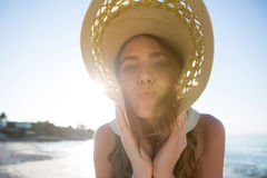 Portrait of woman wearing sun hat at beach. Against clear blue sky on sunny day Stock Photos