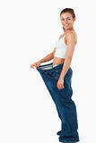Portrait of a woman wearing too large pants Stock Images