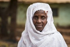 Portrait of a woman wearing a traditional dress with veil, at the Missira neighborhood in the city of Bissau, Guinea Bissau. Bissau, Republic of Guinea-Bissau royalty free stock photography