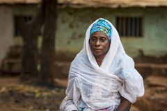 Portrait of a woman wearing a traditional dress with veil, at the Missira neighborhood in the city of Bissau. Bissau, Republic of Guinea-Bissau - February 6 stock photo