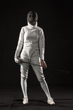 The portrait of woman wearing white fencing costume  on black Stock Photos