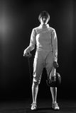 The portrait of woman wearing white fencing costume  on black Royalty Free Stock Photography