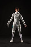 The portrait of woman wearing white fencing costume  on black Royalty Free Stock Images