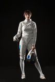 The portrait of woman wearing white fencing costume  on black Royalty Free Stock Photos
