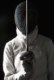 The portrait of woman wearing white fencing Stock Photos