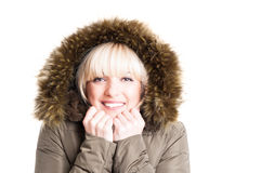 Portrait of woman wearing winter jacket with hood being cold Royalty Free Stock Image