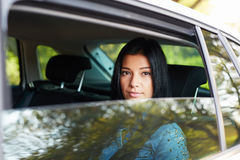 Portrait of woman in the white car stock photos