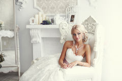 Portrait of a woman in a white dress Stock Photography